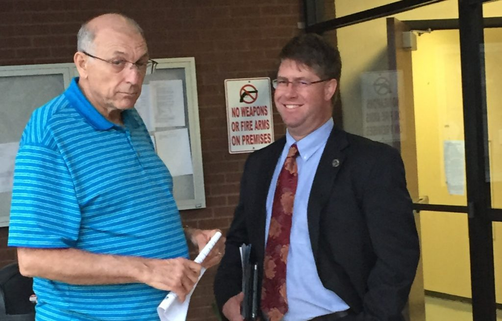 """File photo: Thomas """"Moose"""" Pearce (l) was none to pleased at being photographed with Councilman Aaron Lawler. Pearce was trying to convince Lawler that the April 18 Brookstone subdivision Appeal was above board at the time."""
