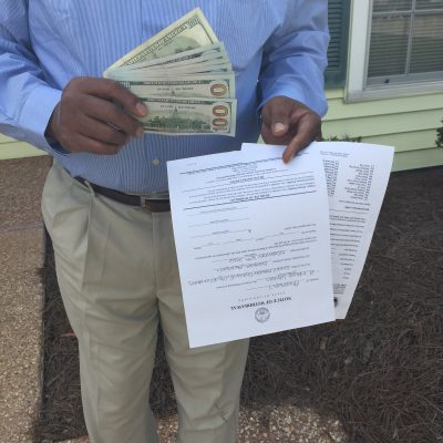 Division E City Council candidate after being handed envelope of cash and form to withdraw from race.